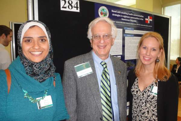 helena chapman and maha eldbary in front of research poster
