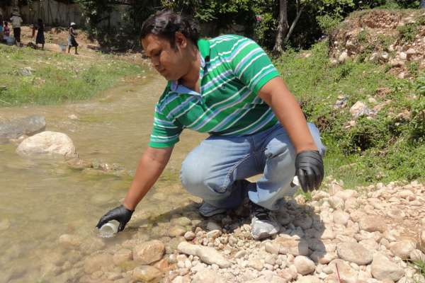 collecting water sample
